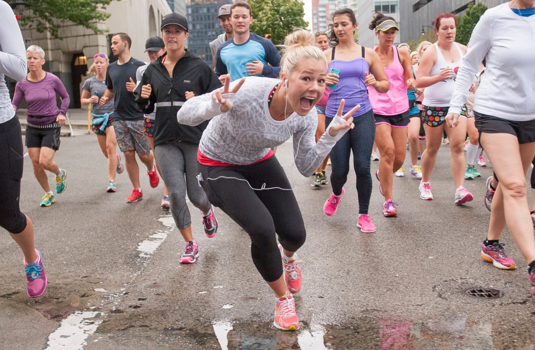 VANCOUVER,BC:AUGUST 15, 2015 -- A runner poses for a photo while making her way along the course of the Lululemon Athletica's 2015 SeaWheeze Half Marathon in Vancouver, BC, August, 15, 2015. (Rich Lam/Lululemon)